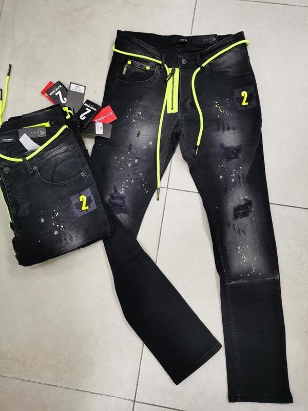 Jeans foncé tirette & cordon fluo vert