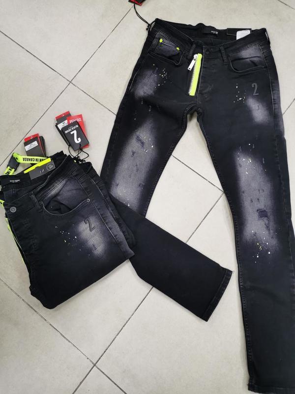 Jeans foncé tirette fluo verte